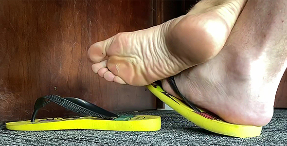 Size 13 Flops and Feet Play under my Desk